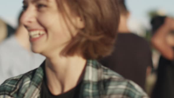 Download Young Girl Smiling and Laughing in Urban Environment nulled download