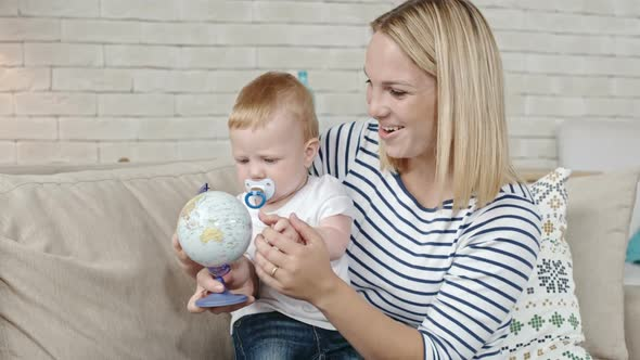 Download Mother Showing Desk Globe to Toddler nulled download