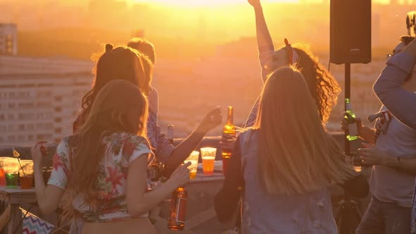VideoHive Young Friends Hanging out at Sunset Party 18128978