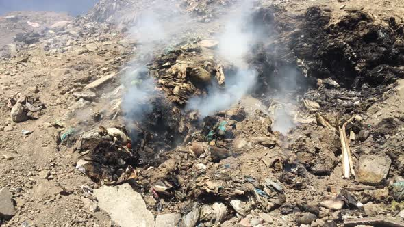 Download Big Heap Of Trash Burning Polluting Atmosphere nulled download