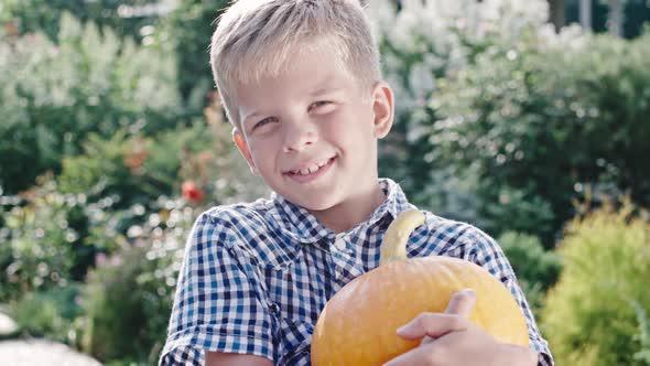 VideoHive Boy with Pumpkin in Green Garden 19675472