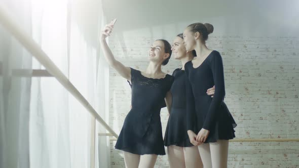 VideoHive Three Young and Beautiful Ballerinas Taking Selfie in a Bright and Modern Studio 19473654