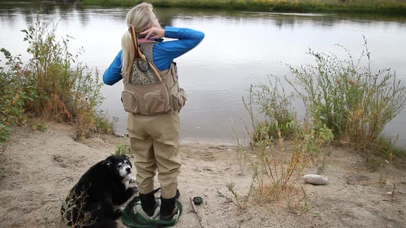 Download Woman Puts On Fly Fishing Vest nulled download