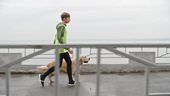 Download Teenage Boy Walking Labrador Dog nulled download