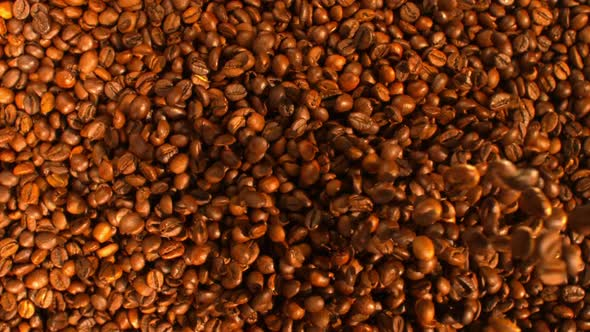 Download Flow Of Coffee Beans Falling Down In The Pile nulled download
