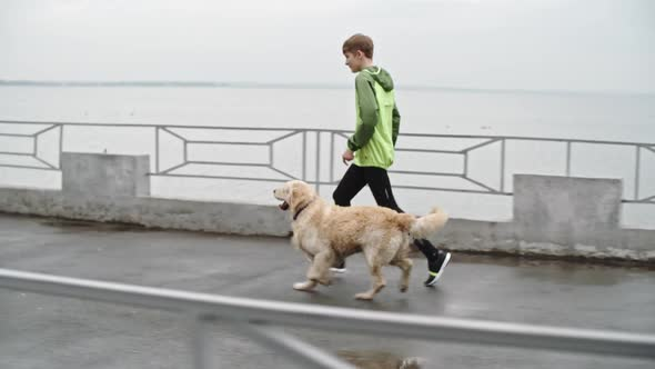 Download Young Boy Runner Training Labrador nulled download