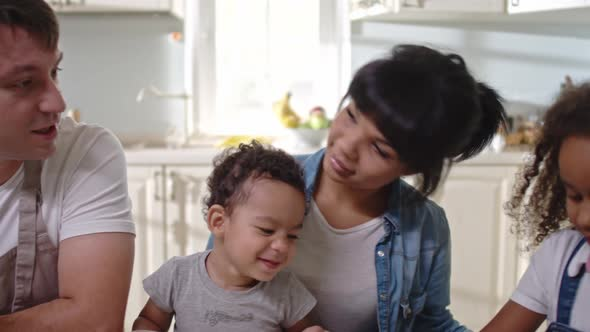 Cute Family Chatting in the Kitchen               (Stock Footage)