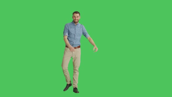 VideoHive Long Shot of a Handsome Smiling Handsome Man Making Presenting Gesture Background is Green Screen 19467227